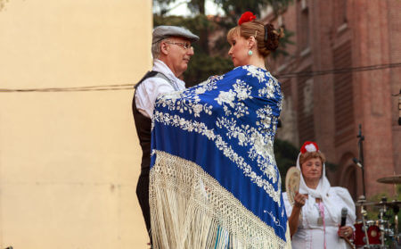 Man and woman dancing during La Paloma festivities