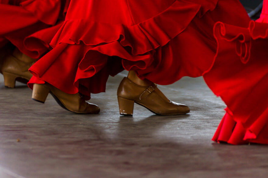 The heels and bottom part of the dress of a flamenco dancer