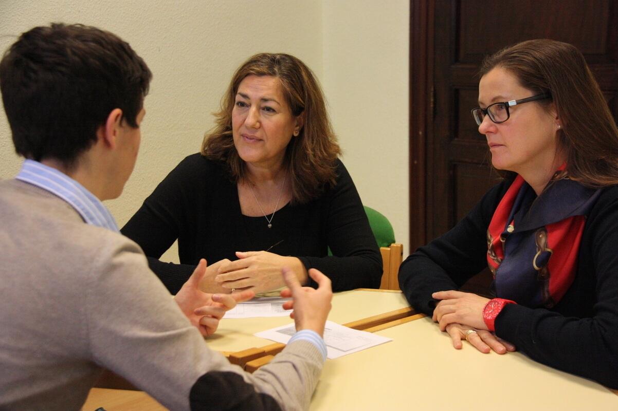 Tandem language exchange at classroom with teacher