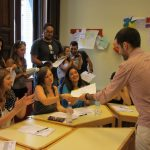 Teacher taking students group exercises, TANDEM Madrid